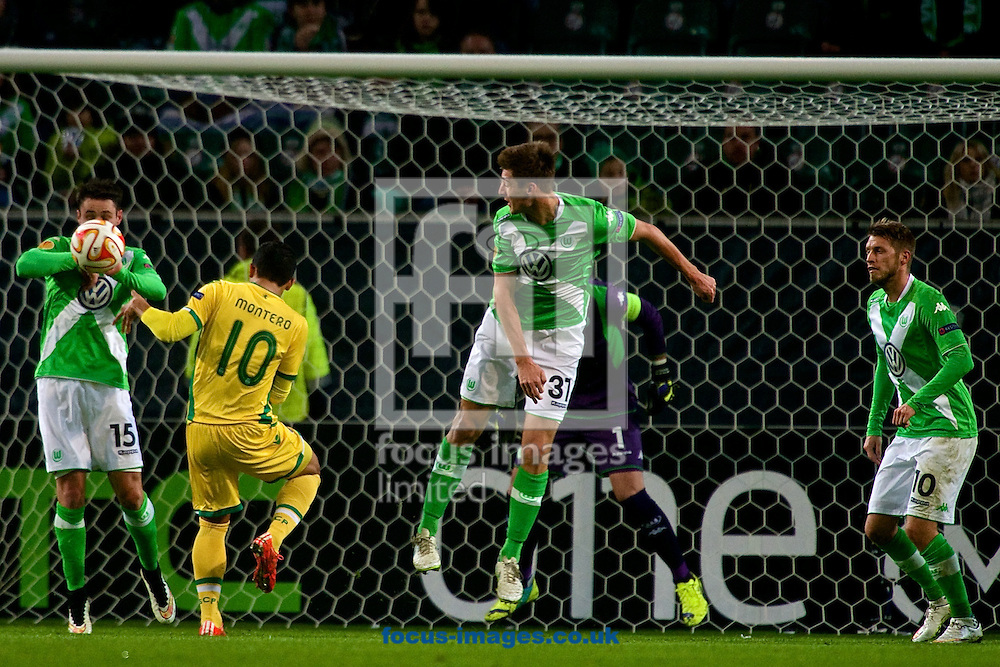 Christian Tr&auml;sch of VfL Wolfsburg appears to handke on his own goal line but no penalty is given during the UEFA Europa League match at Volkswagen Arena, Wolfsburg<br /> Picture by Ian Wadkins/Focus Images Ltd +44 7877 568959<br /> 19/02/2015