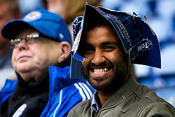 Leicester City fan uses the free clappers as a protector for the rain - Mandatory by-line: Robbie Stephenson/JMP - 29/09/2019 - FOOTBALL - King Power Stadium - Leicester, England - Leicester City v Newcastle United - Premier League