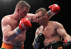 April 9, 2011; Newark, NJ; USA; Tomasz Adamek (Black/Orange) and Kevin McBride (Green/White) during their 12 round heavyweight bout at the Prudential Center in Newark, NJ.  Adamek won via 12 round unanimous decision.