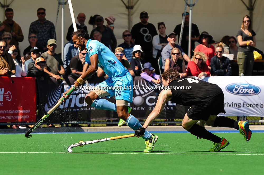 Sunil Sowmarpet Vitalacharva of India is tackled by Nick HAIG of the Black Sticks during the Mens Hockey International, 2015 South Island Tour game between the New Zealand Black Sticks V India, at Marist Park, Christchurch, on the 11th October 2015. Copyright Photo: John Davidson / www.photosport.nz