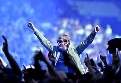 Cardiff City fans flood the pitch to celebrate their promotion to the Premier League after the Sky Bet Championship match at the Cardiff City Stadium.