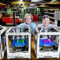 Nederland, Amsterdam , 21 juni 2013.<br /> Maarten Twigt en Johan Schuilenburg van ifabrica achter de 3D printers in hun multi functionele werkplaats ifabrica in Amsterdam Noord.<br /> iFabrica is een open werkplaats waar niet een product voor je wordt gemaakt, maar waar iedereen zijn eigen product kan maken. Deze werkplaats noemen wij een Fabrica, een plek voorzien van geavanceerde machines en gereedschappen voor de bewerking van onder meer hout, metaal, kunststof en textiel. Om je een beeld te geven, denk aan CNC gestuurde freesmachines, plasma- en lasersnijders, lasapparatuur, draaibanken, straalcabines, naaimachines, 3D printers, en huis-tuin-en-keuken gereedschap.<br /> Foto:Jean-Pierre Jans