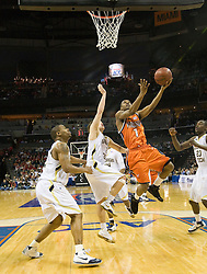 Virginia guard Jeff Jones (1) shoots past Georgia Tech guard Matt Causey (2).  The Virginia Cavaliers faced the Georgia Tech Yellow Jackets in the first round of the 2008 ACC Men's Basketball Tournament at the Charlotte Bobcats Arena in Charlotte, NC on March 13, 2008.