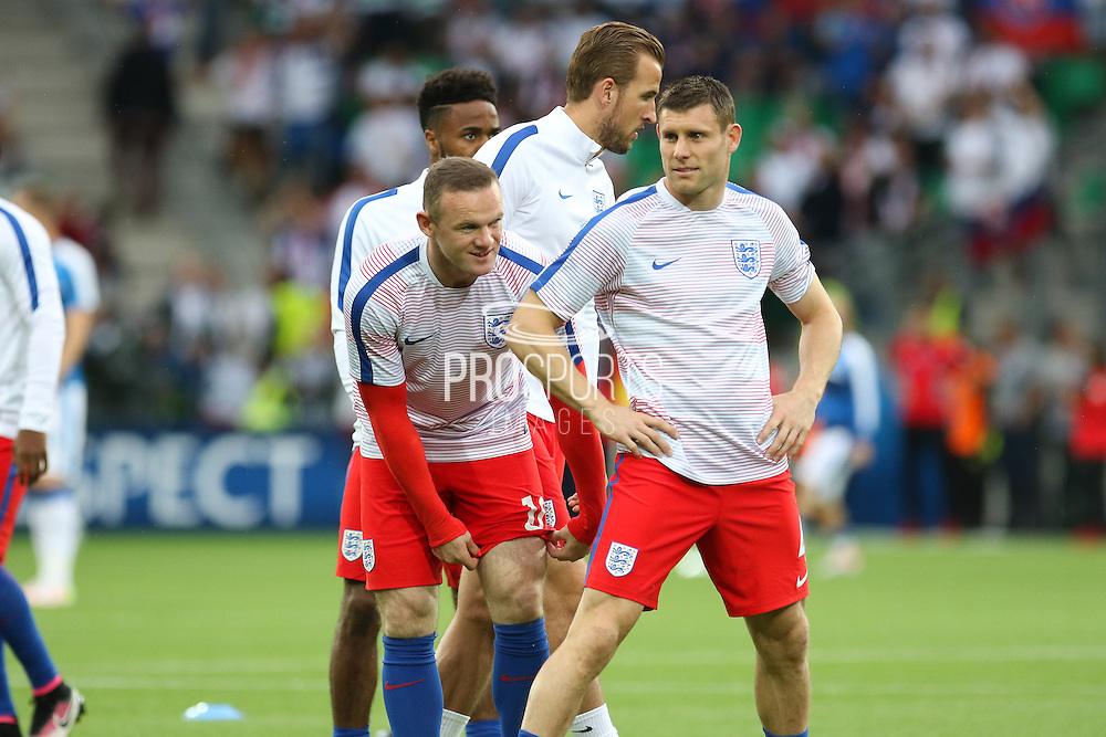 England Forward Wayne Rooney and England Midfielder James Milner share a joke in warm up during the Euro 2016 Group B match between Slovakia and England at Stade Geoffroy Guichard, Saint-Etienne, France on 20 June 2016. Photo by Phil Duncan.