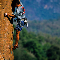 Tamotsu Sugino climbs the orange arete Mind the Bees, 5.13a, Ban Pak Ou, Luang Phrabang, Laos
