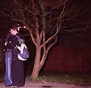 Couple hugging each other on the street, Cardiff 2000's