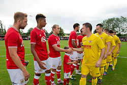 Brislington FC and Bristol City players shake hands prior to kick off - Photo mandatory by-line: Dougie Allward/JMP - Mobile: 07966 386802 - 05/07/2015 - SPORT - Football - Bristol - Brislington Stadium - Pre-Season Friendly