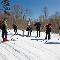 Cross-country skiers on the Hedgehog Gate Trail near Little Lyford Pond Camps near Greenville, Maine.