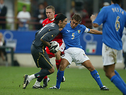 MILAN, ITALY - Saturday, September 6, 2003: Wales' Craig Bellamy is thwarted by Italy's goalkeeper Gianluigi Buffon and Fabio Cannavaro during the Euro 2004 qualifying match at the San Siro Stadium. (Pic by David Rawcliffe/Propaganda)