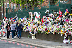 © London News Pictures. 26/05/2013. Woolwich, UK. Flowers at the scene where Drummer Lee Rigby was murdered by two men in Woolwich town centre in what is being described as a terrorist attack. Photo credit: Ben Cawthra/LNP
