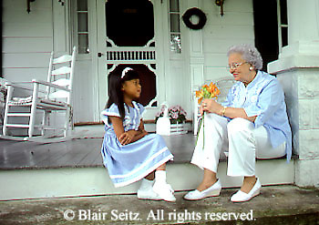 Active Aging Senior Citizens, Retired, Activities, Asian American Child, Asian-American Grandchild, Giving Grandmother Flowers, Child Happy to Give Grandmother Flowers,