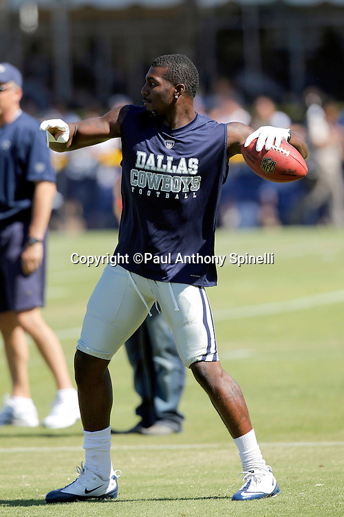 Dallas Cowboys rookie wide receiver Dez Bryant (88) throws a pass during NFL football training camp on Wednesday, August 18, 2010 in Oxnard, California. (©Paul Anthony Spinelli)