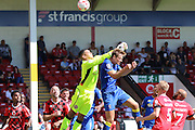Walsall FC goalkeeper Neil Etheridge (1) punches clear during the EFL Sky Bet League 1 match between Walsall and AFC Wimbledon at the Banks's Stadium, Walsall, England on 6 August 2016. Photo by Stuart Butcher.