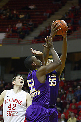 19 November 2011:  Jordan Threloff watches as Marvon Williams controls a ball also sought after by Malcolm Smith during an NCAA mens basketball game between the Lipscomb Bison and the Illinois State Redbirds in Redbird Arena, Normal IL