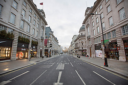 © Licensed to London News Pictures. 25/12/2016. Regent St on Christmas Day. Christmas Day morning saw the West End of London's streets almost completely emptied of people. Credit : Rob Powell/LNP