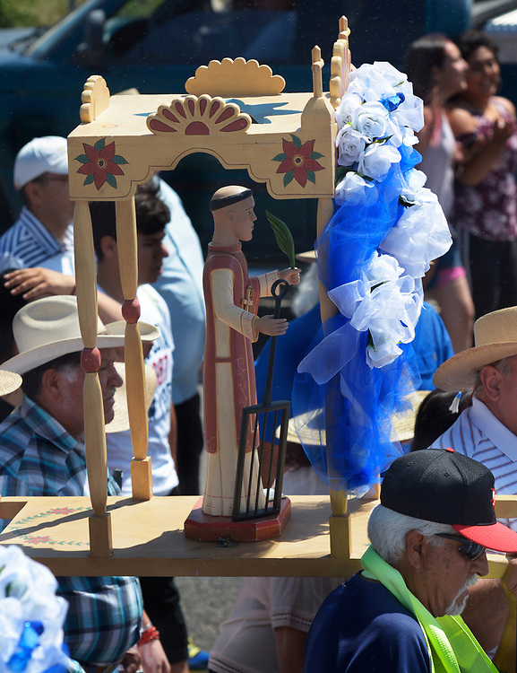 gbs081017e/RIO-WEST -- The Santos statue of San Lorenzo is carried in procession on South Camino del Pueblo from Our Lady of Sorrows Catholic Church during Las Fiestas de San Lorenzo on Thursday, August 10, 2017.(Greg Sorber/Albuquerque Journal)