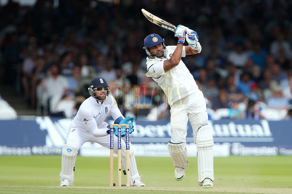 Murali Vijay of India holds his position after playing during day three of the 2nd Investec test match between England and India held at Lords cricket ground in London, England on the 19th July 2014<br /> <br /> Photo by Ron Gaunt / SPORTZPICS/ BCCI
