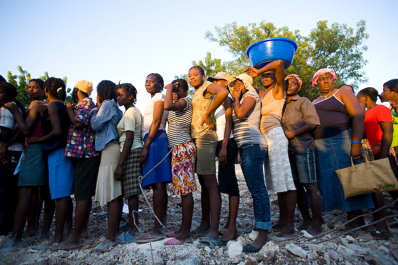 Earthquake victims wait in line during a food distribution. Port Au Prince, Haiti. Photo by Ben Depp.1/20/2010.