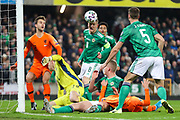 Northern Ireland midfielder Steven Davis (8) gets his head to the ball to clear the danger during the UEFA European 2020 Qualifier match between Northern Ireland and Netherlands at National Football Stadium, Windsor Park, Northern Ireland on 16 November 2019.