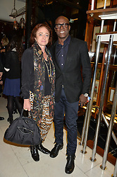 CAMILLA LOWTHER and CHARLES ABOAH at a dinner to celebrate the publication of Obsessive Creative by Collette Dinnigan hosted by Charlotte Stockdale and Marc Newson held at Mr Chow, Knightsbridge, London on 9th February 2015.
