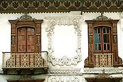 ECUADOR, HIGHLANDS, CUENCA colonial architecture; balconies