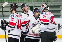 Dominique Heinrich of Austria and Bernhard Starkbaum of Austria celebrate after the ice-hockey match between Austria and Great Britain at IIHF World Championship DIV. I Group A Slovenia 2012, on April 16, 2012 in Arena Stozice, Ljubljana, Slovenia. Austria defeated Great Britain 6-3. (Photo by Vid Ponikvar / Sportida.com)