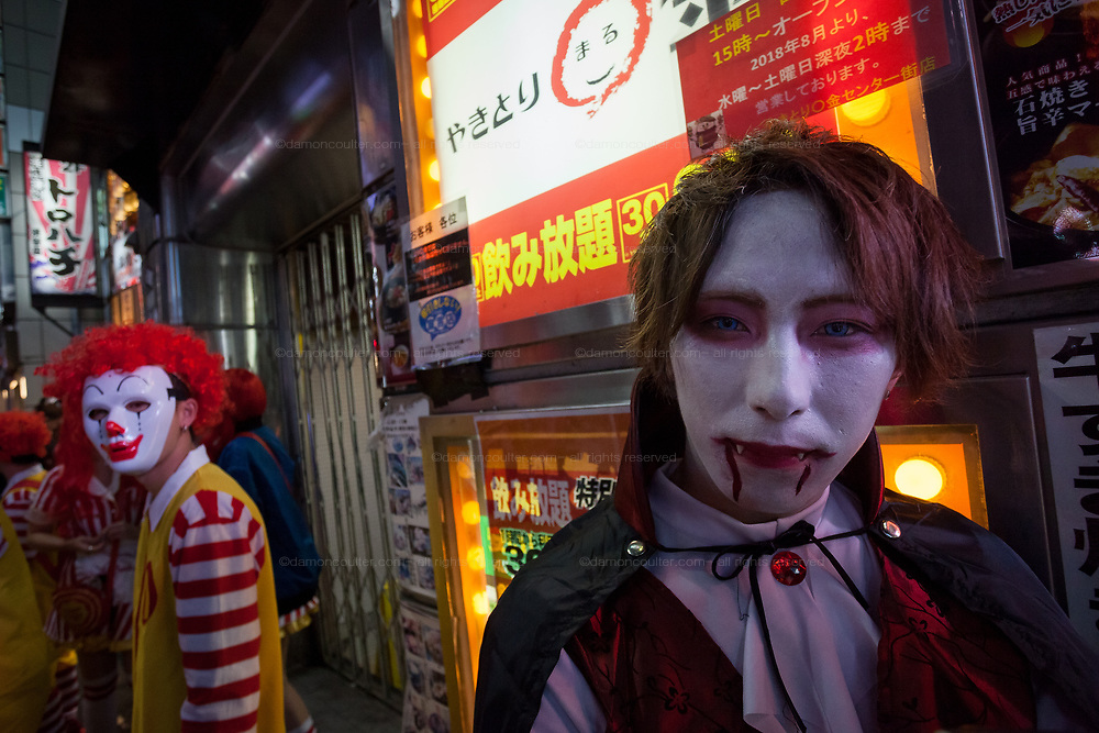 A man dressed as a vampire during the Halloween celebrations Shibuya, Tokyo, Japan. Saturday October 27th 2018. The celebrations marking this event have grown in popularity in Japan recently. Enjoyed mostly by young adults who like to dress up, drink , dance and misbehave in parts of Tokyo like Shibuya and Roppongi. There has been a push back from Japanese society and the police to try to limit the bad behaviour.