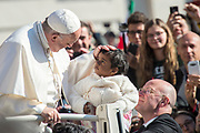 April 19. 2017: Pope Francis blesses a baby girl as he arrives for his weekly general audience in St Peter's square at the Vatican. Antoine Mekary | Aleteia | I.Media