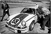 1973 Daytona 24-hour race  •  February 4, 1973  •  winner  •  Porsche 911 Carrera RSR  •  Jack Atkinson/crew chief at left  •  winner for Peter Gregg/Hurley Haywood  •  Gregg with his head in window talking to Haywood