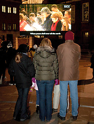 ©London News Picures..Live screening of St Paul's Cathedral's Christmas carol service. A 25m screen in adjacent Paternoster Square broadcasted the service live, for the first time in London. Photo credit should read Fuat Akyuz/London News Pictures.