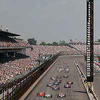 28 May, 2006, Indianapolis Motor Speedway, USA.<br /> Sam Hornish, Jr., Helio Castroneves and Dan Wheldon race for the lead at the start.<br /> &copy; 2006 Phillip Abbott/USA<br /> LAT Photographic