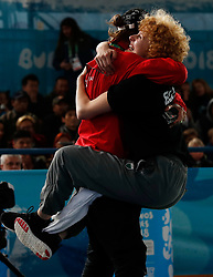 BUENOS AIRES, Oct. 12, 2018  Ella (R) of Austria celebrates with her coach after the breaking mixed team bronze medal battle at the Buenos Aires 2018 Youth Olympic Games in Buenos Aires, Argentina on Oct. 11, 2018. Ella of Austria/Bumblebee of Russia won the bronze. (Credit Image: © Wang Lili/Xinhua via ZUMA Wire)