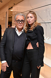 GIUSEPPE ZANOTTI and ABBEY CLANCY  at the launch of the new Giusepe Zanotti store in Conduit Street, London on 26th October 2016.