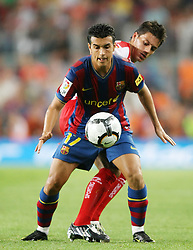 FC Barcelona's Pedro Rodriguez (f) and Sporting de Gijon's Michel Madera during  La Liga match.August 31 2009.