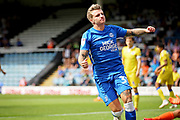 Peterborough United forward Jason Cummings (35) celebrates his teammates Peterborough United forward Matt Godden (9) goal during  the EFL Sky Bet League 1 match between Peterborough United and Bristol Rovers at London Road, Peterborough, England on 4 August 2018. Picture by Nigel Cole.