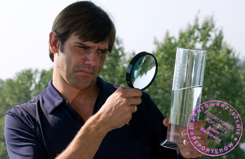 BARTOSZ KIZIEROWSKI (POLISH SWIMMER KONRAD CZERNIAK'S TRAINER) POSES WITH MENSUR OF WATER IN WARSAW, POLAND..BARTOSZ KIZIEROWSKI IS FORMER SWIMMER (OLIMPIAN THREE TIMES AND TWO TIMES BRONZE MEDALIST WORLD CHAMPIONSHIPS AND TWO TIMES EUROPEAN CHAMPION)...POLAND, WARSAW , AUGUST 27, 2011..( PHOTO BY ADAM NURKIEWICZ / MEDIASPORT )..PICTURE ALSO AVAIBLE IN RAW OR TIFF FORMAT ON SPECIAL REQUEST.