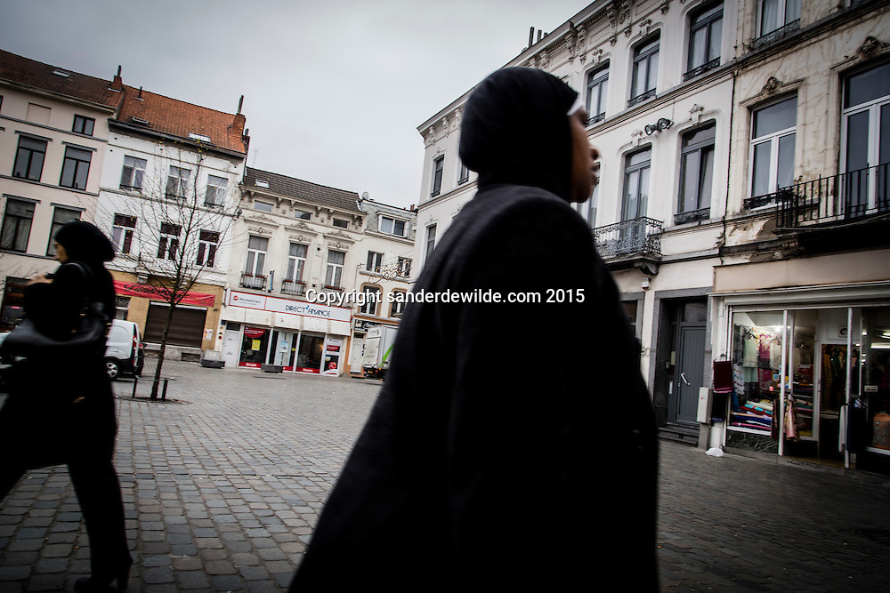 2015 november 16. Brussels, Belgium, Sint Jans Molenbeek.Muslim women walk on the square in front of the town hall. The house of the Abdeslam family just right next to the fabric store