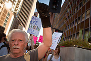 "22 OCTOBER 2011 - PHOENIX, AZ:    Occupy Phoenix protesters march through downtown Phoenix Saturday. The demonstrations at Occupy Phoenix, AZ, entered their second week Saturday. About 50 people are staying in Cesar Chavez Plaza, in the heart of downtown. The crowd grows in the evening and on weekends. Protesters have coordinated their actions with police and have gotten permission from the city to set up shade shelters and sleep in the park, but without tents or sleeping bags, which is considered ""urban camping,"" instead protesters are sleeping on the sidewalk. PHOTO BY JACK KURTZ"