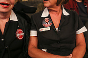 Supporters wearing their work uniforms sporting Trump pins wait to hear Republican presidential candidate Donald Trump speak at a town meeting at Atkinson Country Club in Atkinson, N.H., Monday, Oct. 26, 2015.  (AP Photo/Cheryl Senter)