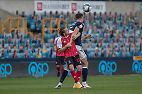 Football - 2020 / 2021 EFL Cup - Round Two - Millwall vs Cheltenham Town<br /> <br /> Alfie May (Cheltenham Town) tussles with the bigger figure of Jake Cooper (Millwall FC) at The Den.<br /> <br /> COLORSPORT/DANIEL BEARHAM