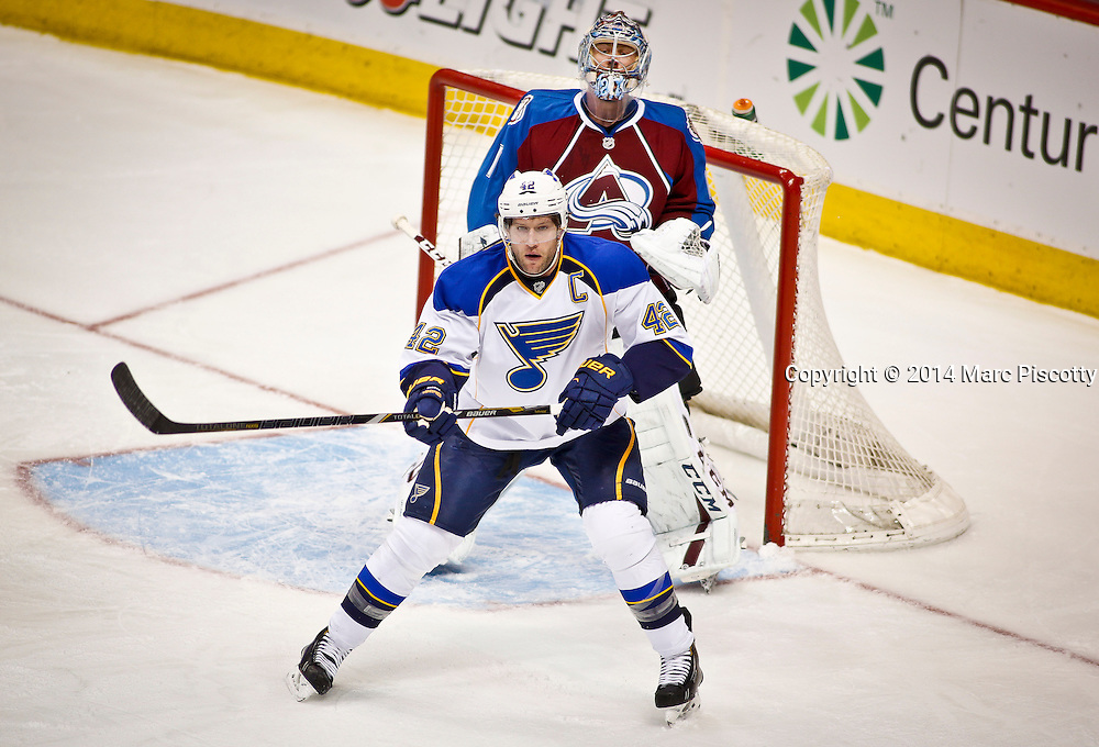 SHOT 3/8/14 2:11:41 PM - Colorado Avalanche goaltender Semyon Varlamov #1tries to see around the screen of the St. Louis Blues' David Backes #42 during their regular season Western Conference game at the Pepsi Center in Denver, Co. The Blues won the game 2-1.<br /> (Photo by Marc Piscotty / &copy; 2014)