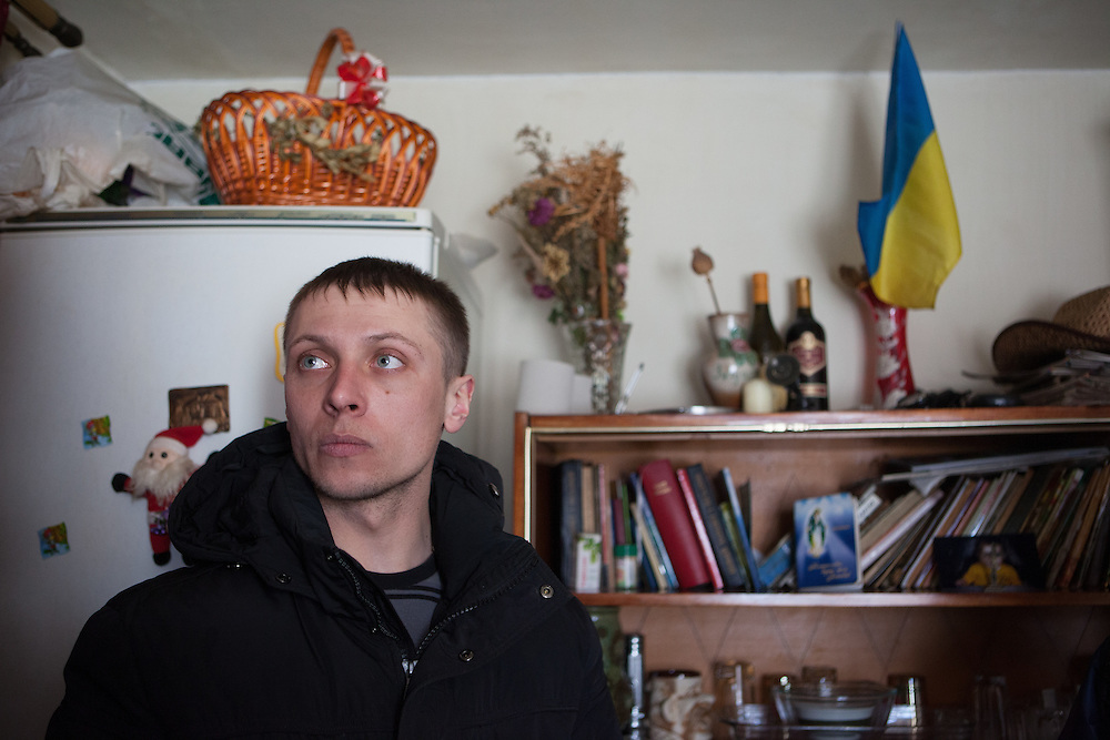 Activist Andrej in the house of his parents.