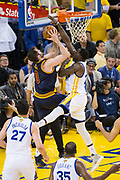 Golden State Warriors forward Draymond Green (23) blocks a lay up by Cleveland Cavaliers forward Kevin Love (0) during Game 1 of the NBA Finals at Oracle Arena in Oakland, Calif., on June 1, 2017. (Stan Olszewski/Special to S.F. Examiner)