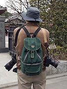the photographer seen from behind