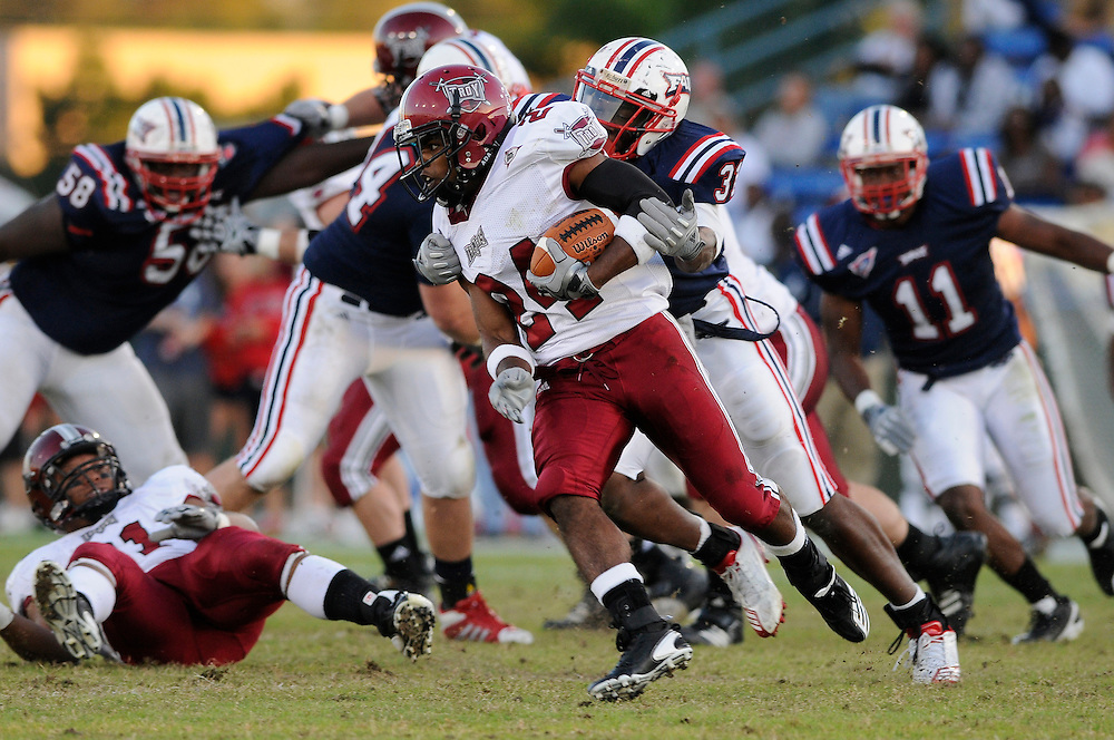 December 4, 2010: T.J. Mitchell of the Troy Trojans runs upfield as Cory Henry of the Florida Atlantic Owls gives chase during the NCAA football game between Troy and the FAU. The Trojans defeated the Owls 44-7.