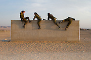 Israeli women serving in the army on an obstacle course, Negev desert, Israel. Photography by Debbie Zimelman