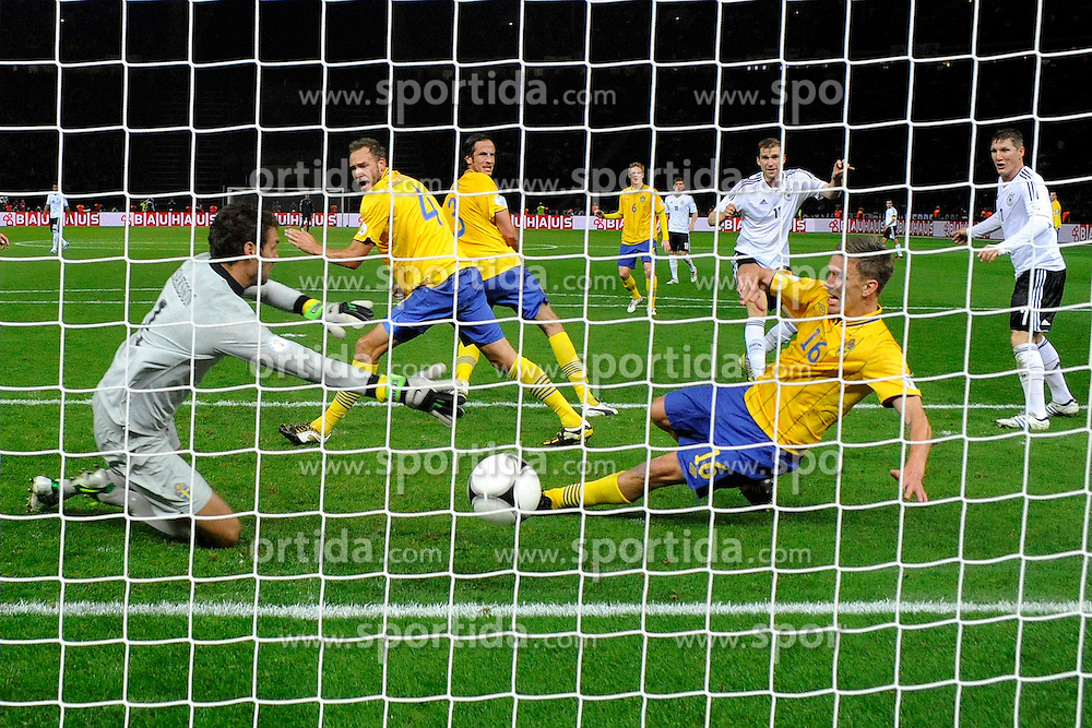 16.10.2012, Olympia Stadion, Berlin, GER, FIFA WM Qualifikation, Deutschland vs Schweden, im Bild Per Mertesacker trifft zum 3:0// during the FIFA World Cup Qualifier Match between Germany and Sweden at the Olympic Stadium, Berlin, Germany on 2012/10/16. EXPA Pictures © 2012, PhotoCredit: EXPA/ Eibner/ mssp***** ATTENTION - OUT OF GER *****