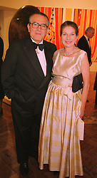 SIR HARRY & LADY DJANOGLY at a dinner in London on 27th May 1998. MHX 38