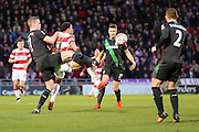 Stoke City defender Ryan Shawcross nicks the ball away from Doncaster Rovers forward Nathan Tyson  during the The FA Cup third round match between Doncaster Rovers and Stoke City at the Keepmoat Stadium, Doncaster, England on 9 January 2016. Photo by Simon Davies.