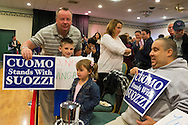 Albertson, New York, U.S. 26th October 2013. L-R, KEVIN DOOLIN and FINNEGAN CORCORAN-DOOLIN, 8, of Bellmore, RILEY GALANTA, 3, of Mineola, and RANDY KOVAR of Massapequa, are in the audience when New York Governor Cuomo endorses Suozzi for Nassau County Executive, at the Albertson Veterans of Foreign Wars VFW Post. Democrat Suozzi, the former Nassau County Executive, and Republican incumbent Mangano face each other in a rematch in the upcoming November 5th election.